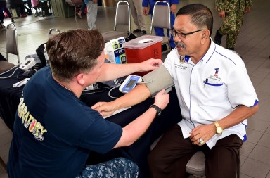 170421-N-QV906-066 KUCHING, Malaysia (April 21, 2017) Lt. John Stephan applies a blood pressure cuff to a patient at a Community Health Outreach Event during Pacific Partnership 2017 Kuching April 21. Pacific Partnership is the largest annual multilateral humanitarian assistance and disaster relief preparedness mission conducted in the Indo-Asia-Pacific and aims to enhance regional coordination in areas such as medical readiness and preparedness for manmade and natural disasters. (U.S. Navy photo by Mass Communication Specialist 1st Class Micah Blechner/Released)